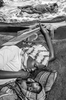 Exhausted from long journey to escape the fighting and taking her malnourished baby to medical care, a young mother rests her tired body and soul at MSF (Doctors without Borders) hospital in Bunia.