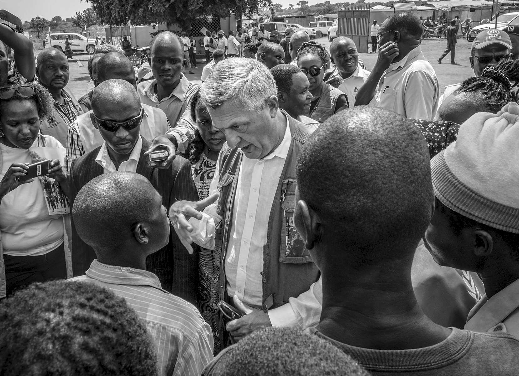 "Filippo Grandi, United Nations High Commissioner for Refugees, engages refugees from South Sudan at Pagrinya refugee resettlement in Adjumani district of Uganda August 29, 2016. Grandi was recently quated by the Guardian newspaper saying Uganda  is now ""at breaking point"".""Uganda has continued to maintain open borders,"" said Ruhakana Rugunda, Uganda's prime minister. ""But this unprecedented mass influx is placing enormous strain on our public services and local infrastructure."" © Jiro Ose"