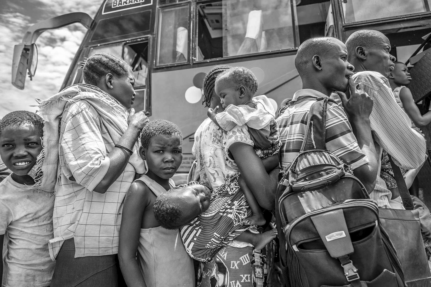 Recently arrived South Sudanese refugees, majority of them women and children, wait to be transported to the reception center at Kuluba collection point in Koboko district in Northern Uganda near South Sudan 1 May, 2017. © Jiro Ose