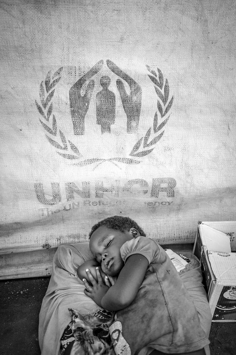 Exhausted from a long and treacherous journey from South Sudan, a young girl sleeps safely at Kuluba collection point in Koboko district in Northern Uganda near South Sudan 1 May, 2017. © Jiro Ose