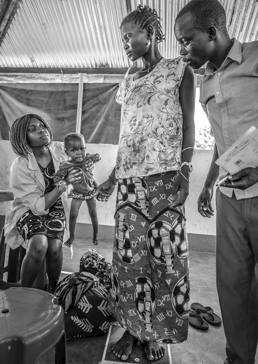 Children are being screened for malnutrition at a health center in Nyumanzi refugee settlement in Adjumani District of Northern Uganda 3 May 2017. © Jiro Ose