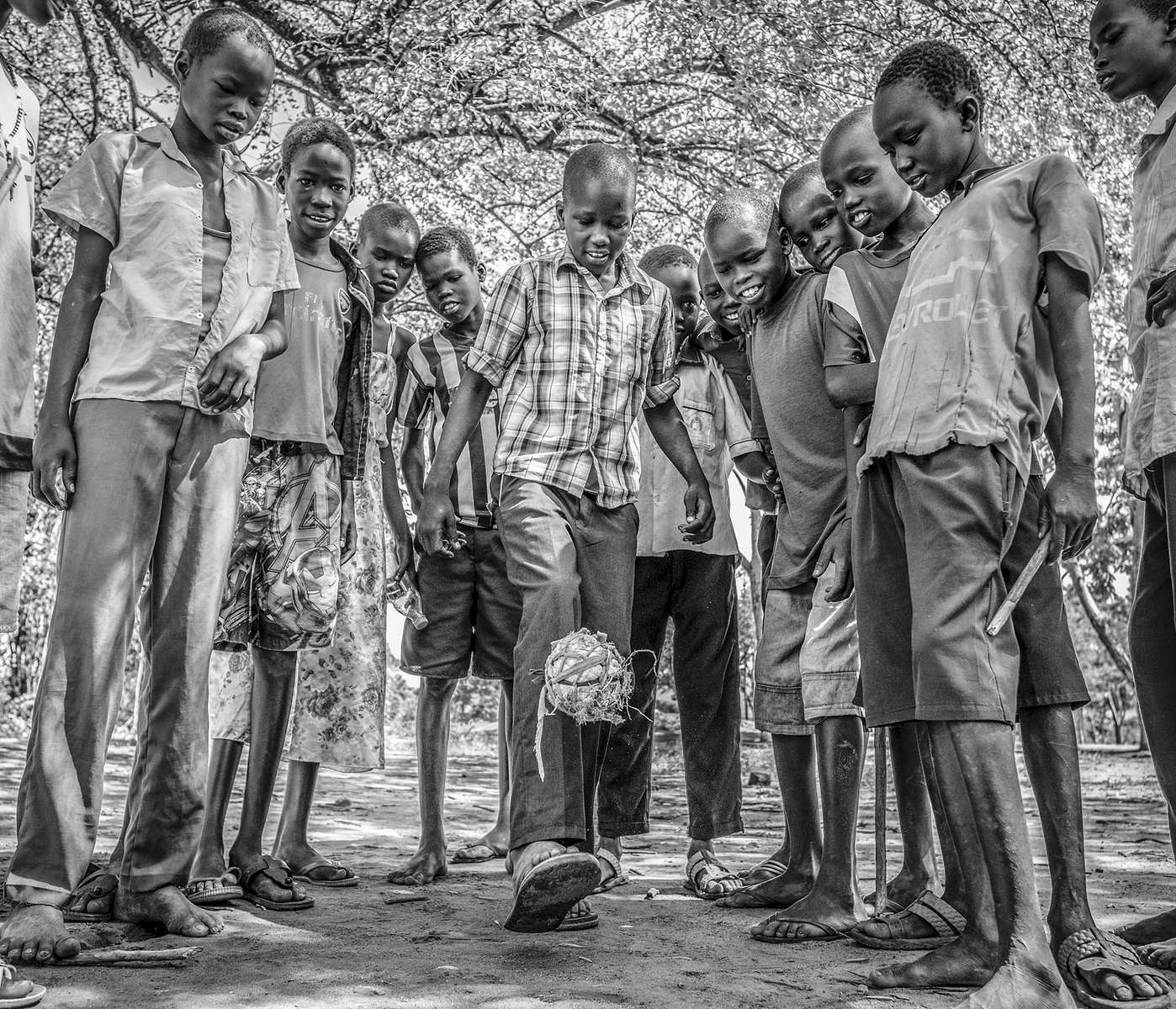Pupils show their fancy footwork with a home-made football at Nymanzi refugee settlement in Adjumani district in Nothern Uganda 3 May 2017. © Jiro Ose