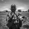 South Sudanese refugee shows a groundnut about to be planed at Nymanzi refugee settlement in Adjumani district in Northern Uganda 3 May 2017. Uganda has one of the world's most compassionate refugee policies, granting land to build a home and cultivate, rights to travel and work. © Jiro Ose