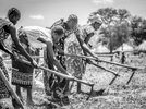 South Sudanese refugees till the earth for planning at Nymanzi refugee settlement in Adjumani district in Northern Uganda 3 May 2017. Uganda has one of the world's most compassionate refugee policies, granting land to build a home and cultivate, rights to travel and work. © Jiro Ose