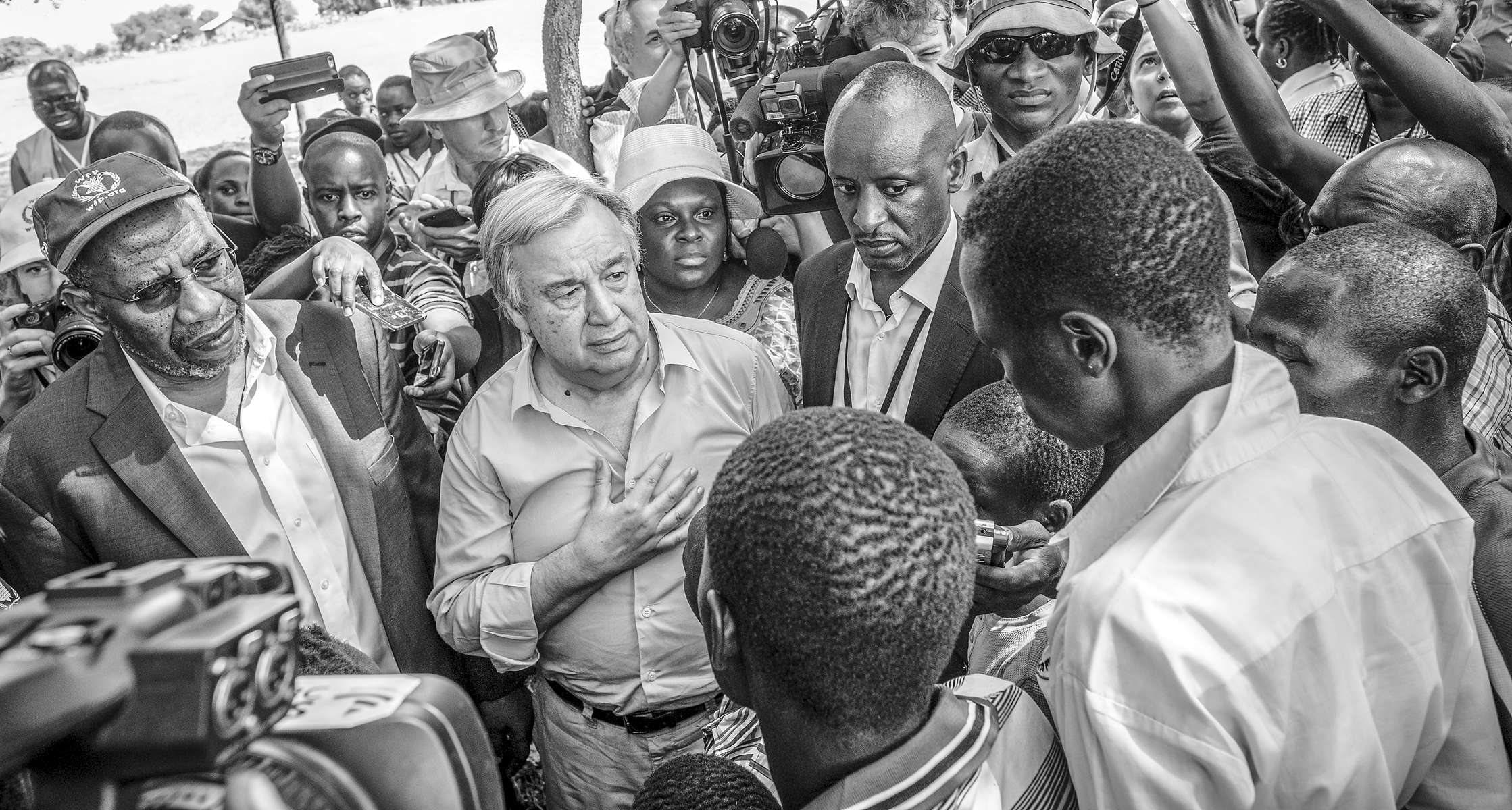 UN Secretary General Antonio Gutierres listens to South Sudanese refugees at Imvepi refugee settlement in northern Uganda 22 June 2017. According to the UN refugee agency more than 947,000 South Sudanese refugees are sheltering in Uganda, bringing the total number of refugees in the east African nation to more than 1.2 million, hosting the largest numbers of refugees in Africa. .