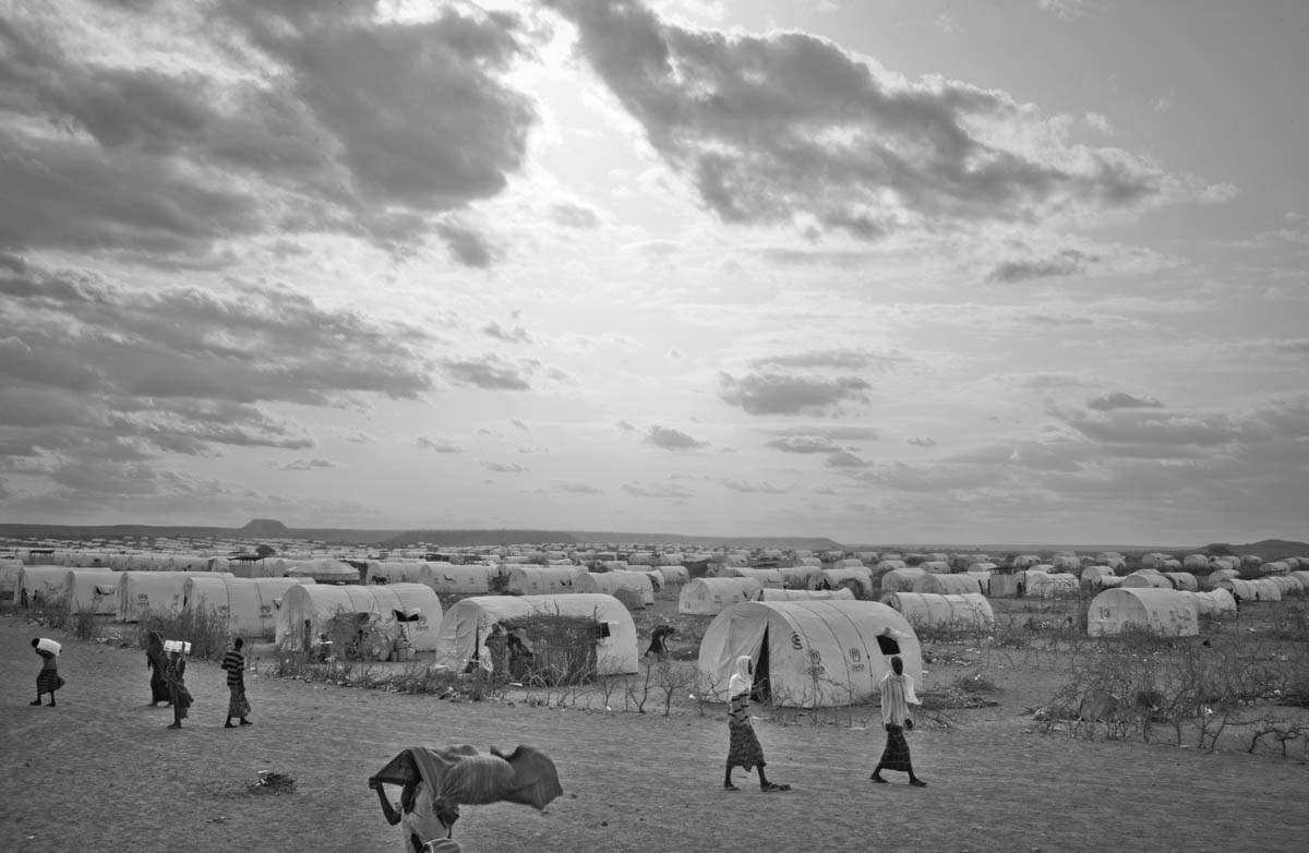 Somali refugees walk about in Kobe Refugee camp in southeastern Ethiopia, a few kilometers from Somalia/Ethiopia border, Wed. 10 August, 2011.