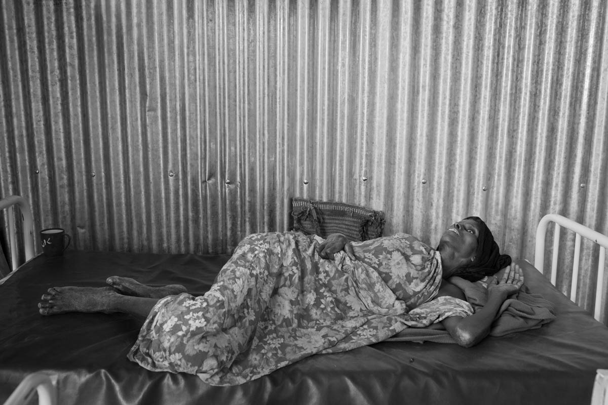 Severely malnourished, dehydrated, and sick Somali woman waits for her turn to be treated at a health clinic in Kobe Refugee camp in southeastern Ethiopia, a few kilometers from Somalia/Ethiopia border, Wed. 10 August, 2011.