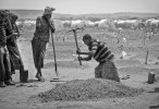 A grave is being dug for 1 1/2-year-old Sahro Mohammed in Kobe Refugee Camp in southeastern Ethiopia, a few kilometers from Somalia/Ethiopia border, Wed. 12 August, 2011.