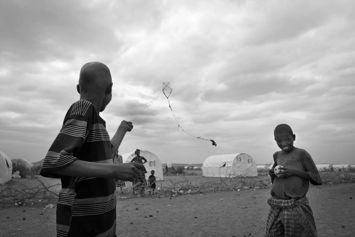 Somali refugee children try to find normalcy by flying a kite in Kobe Refugee Camp in southeastern Ethiopia, a few kilometers from Somalia/Ethiopia border, Wed. 10 August, 2011.