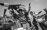 Kurds cheer for the fall of Saddam Hussein on the street of Sulymania.