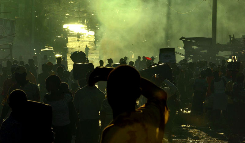 Port-au-Prince wakes up in the chaos, the confusion and the smoke from burning trash.