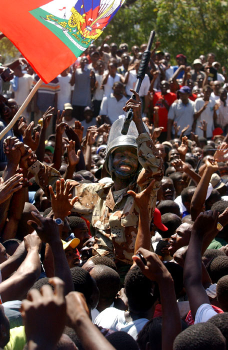 A member of rebellion is being celebrated by the supporters in the main square in Port-au-Prince.