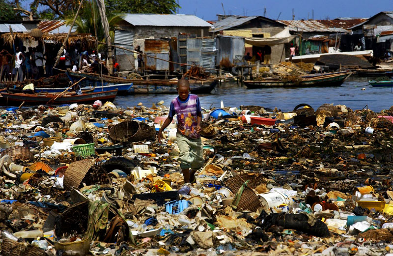 A boy navigates through garbage at the water front in Port-au-Prince.