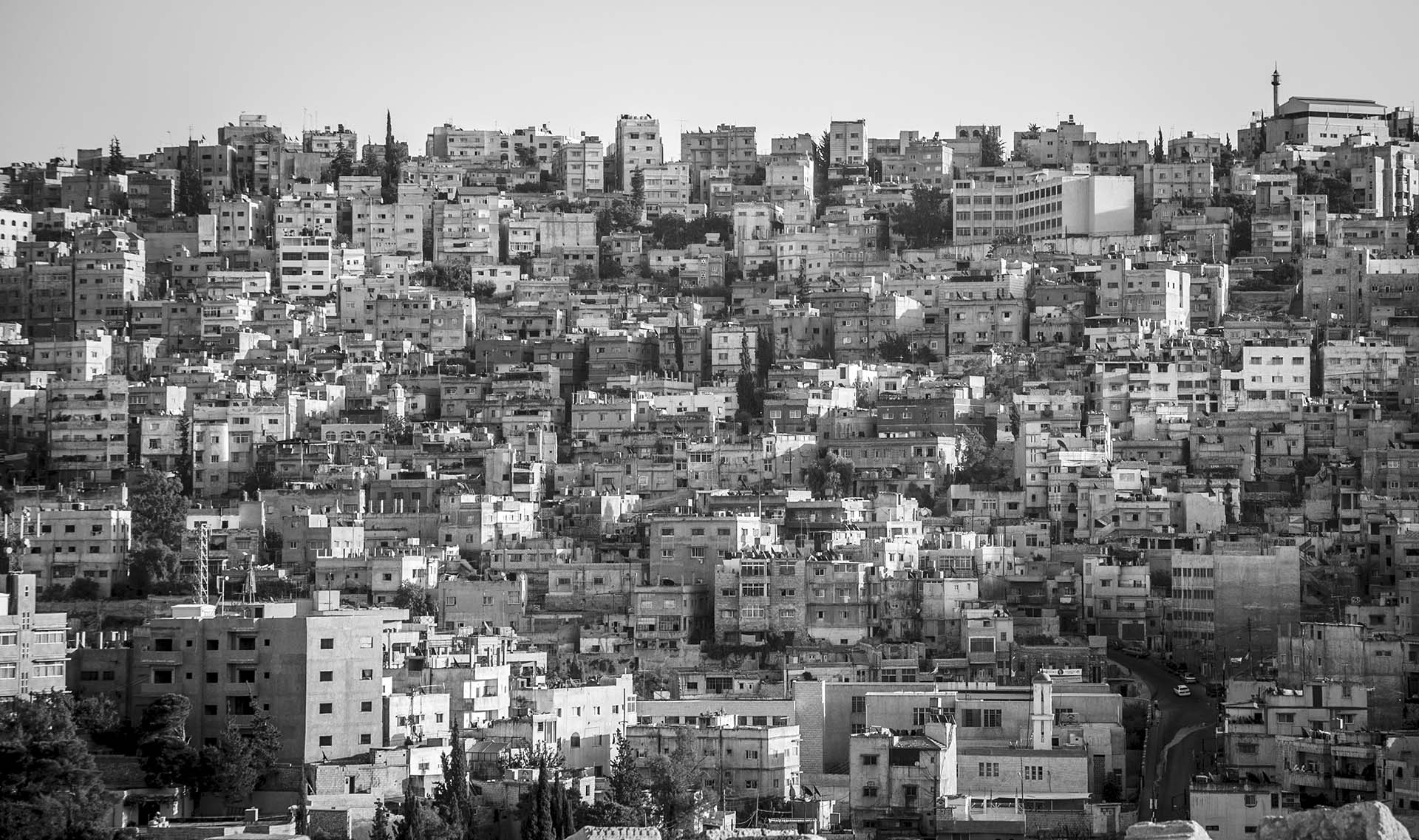 Afraid of deportation, most Iraqi refugees stay indoors in densely populated Amman, Jordan.