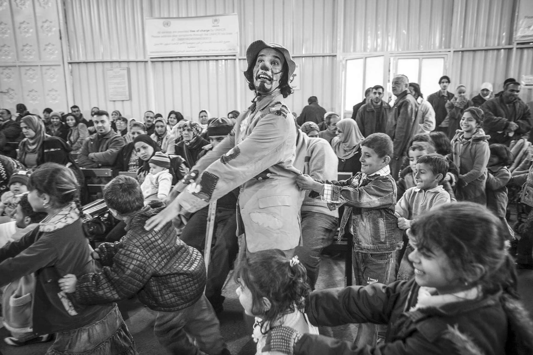 Crowsn Without Borders entertain refugee children in Damascus.