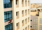 Window washer makes his way down at the campus of Wipro Technologies in Bangalore.