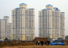 High-end apartment buildings are springing up like mashrooms in Gurgaon, outside New Delhi.