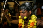 Hindu divotees shows his religious commitment by skewing his cheeks duirng a festival in Allepay, India.