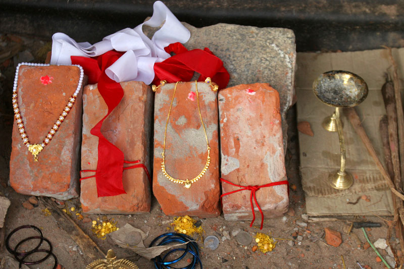 Mementos of deceased family members inside a make-shift shrine built at the site where their house used to stand.