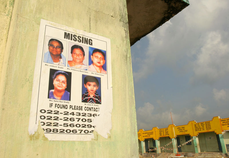 A poster of missing family members are posted at a public school on the hill. Over 6,000 are confirmed dead and many are missing in the area.