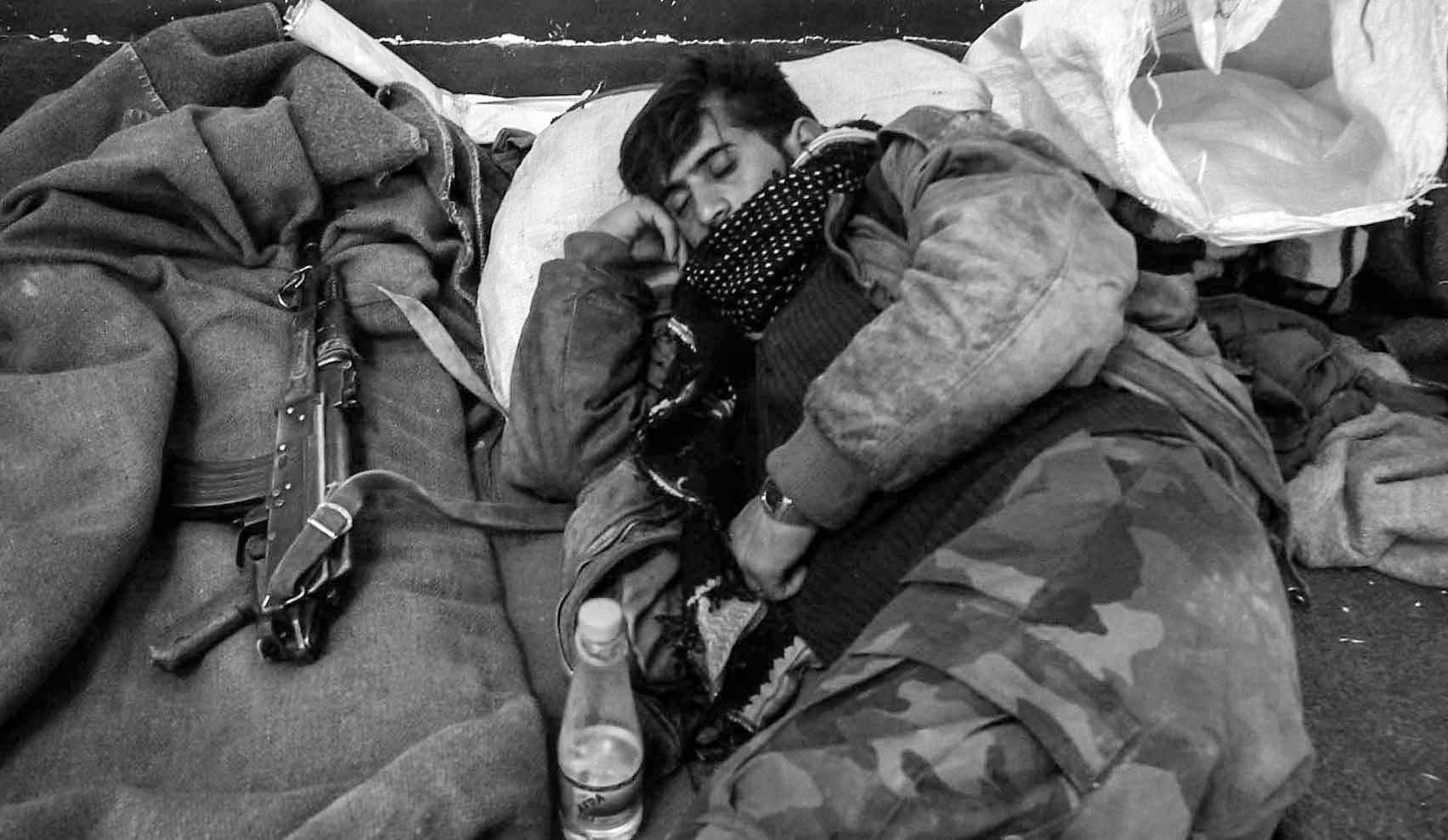 Kurdish solder takes a nap inside a mosk in the village of Gulp, which was taken over recently from Ansar al-Islam, Islamic fundamentalist group.