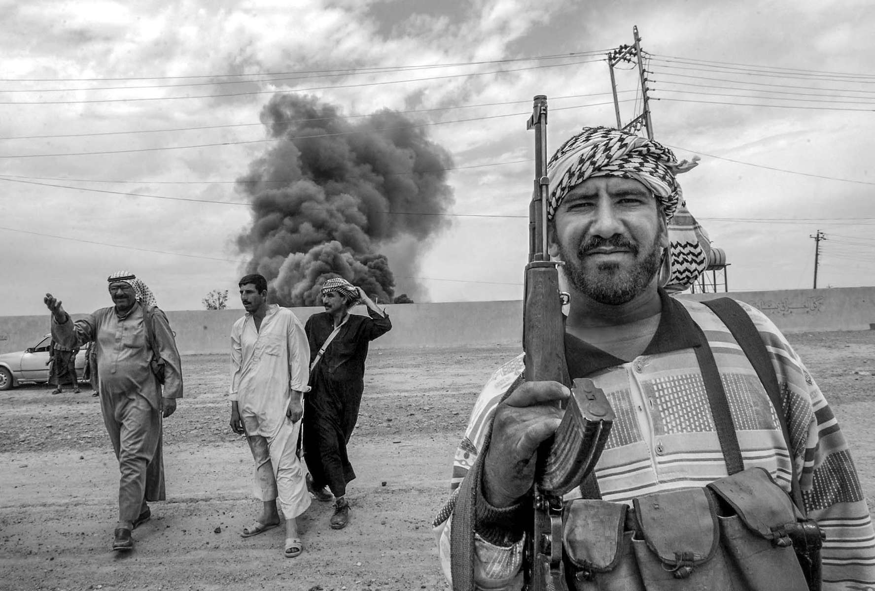 Residents of an Arab village near Kirkuk armed themselves for the protection from Kurds, afraid of retaliation when Suddan Hussein's forces left the city.