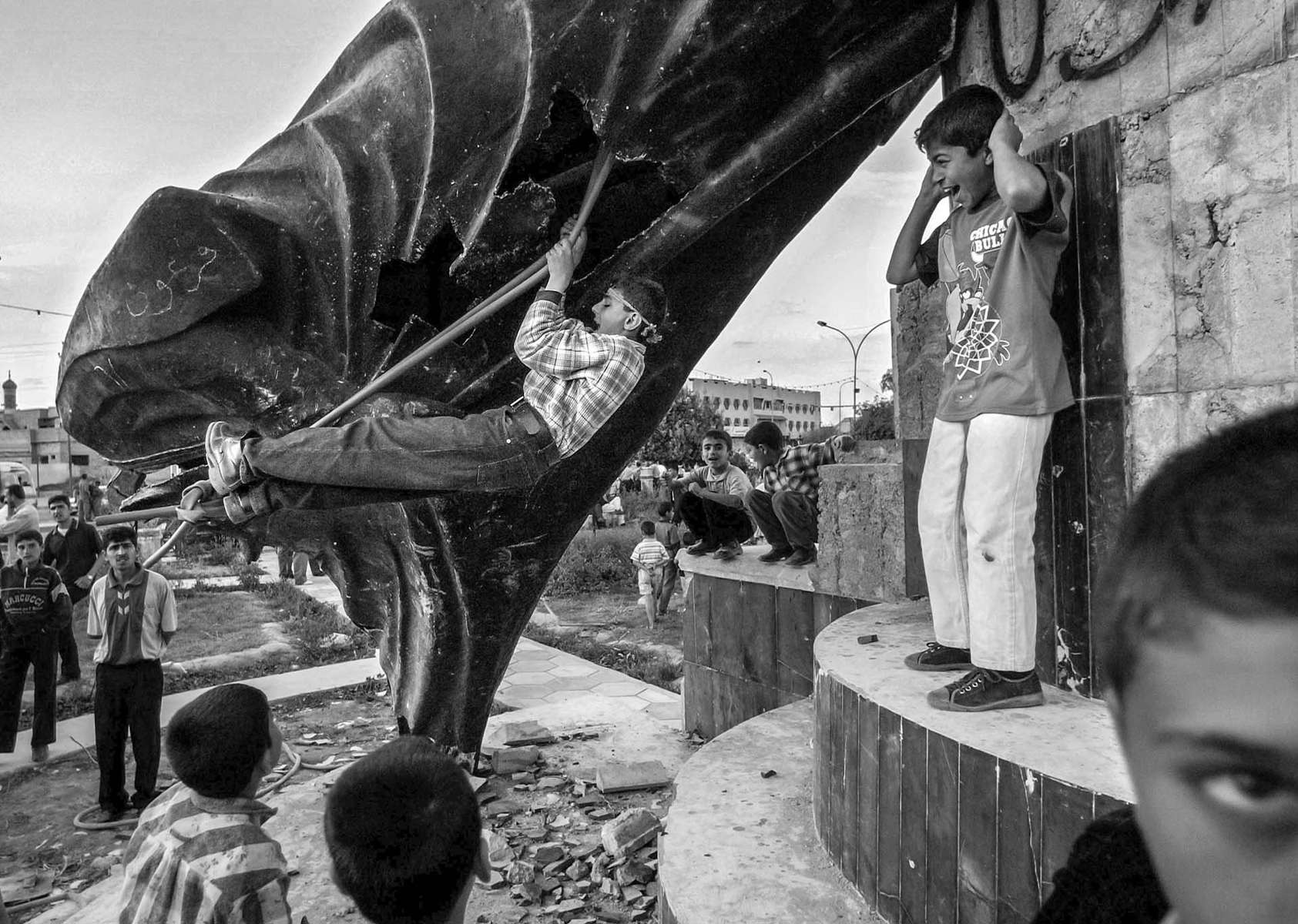 Kurdish children found a new use of Saddam's statue , making into a swing at a main square in northern Iraqi town of Kirkuk.