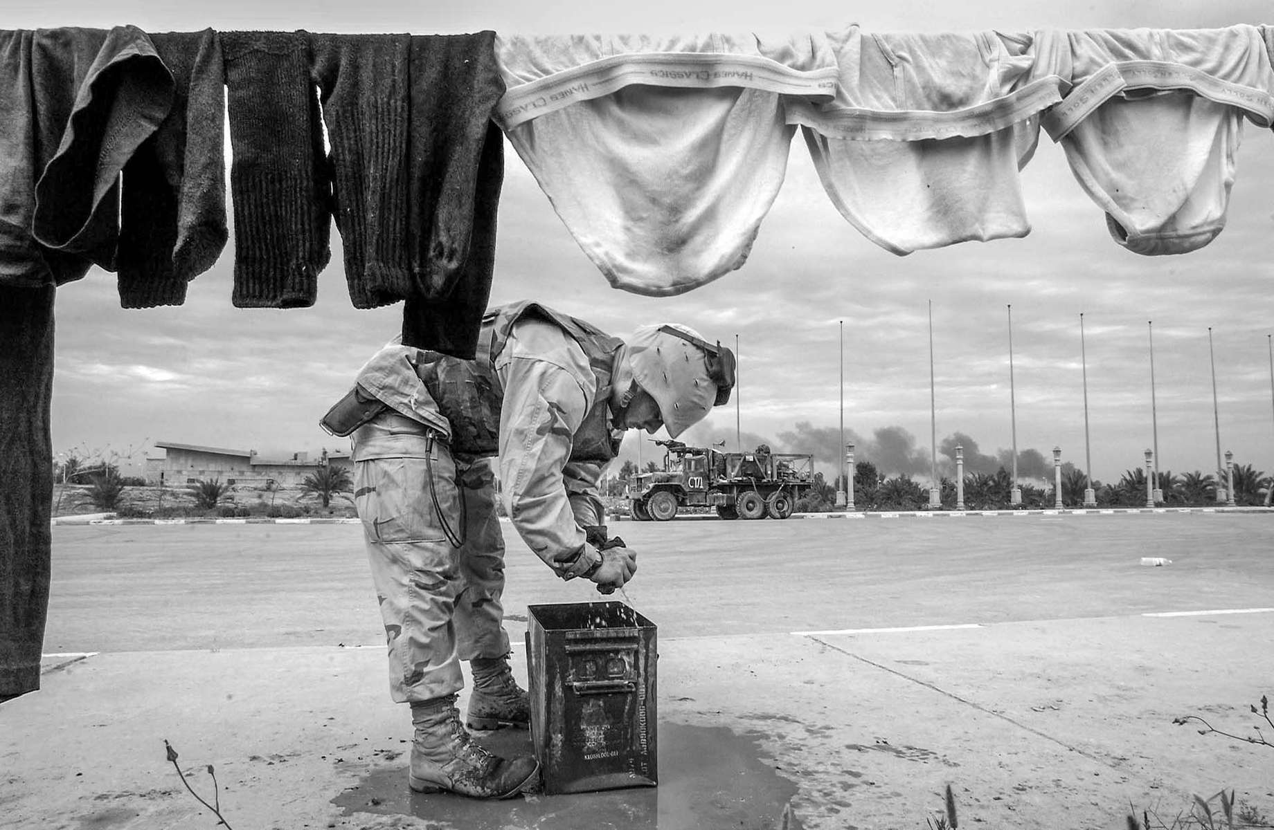 Brian Clark of the 1st Light Armored Division does his chore at Saddam Hussain's palece in the city of Tikrit.
