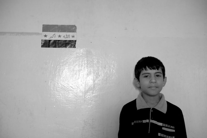 Mandean (Sabian) boy, Iraqi ethnic minority, stands at his basement apartment in Eastern Amman, Jordan November 11, 2007. They are on the verge of extinction in Iraq due to ethnic violence targeting them.