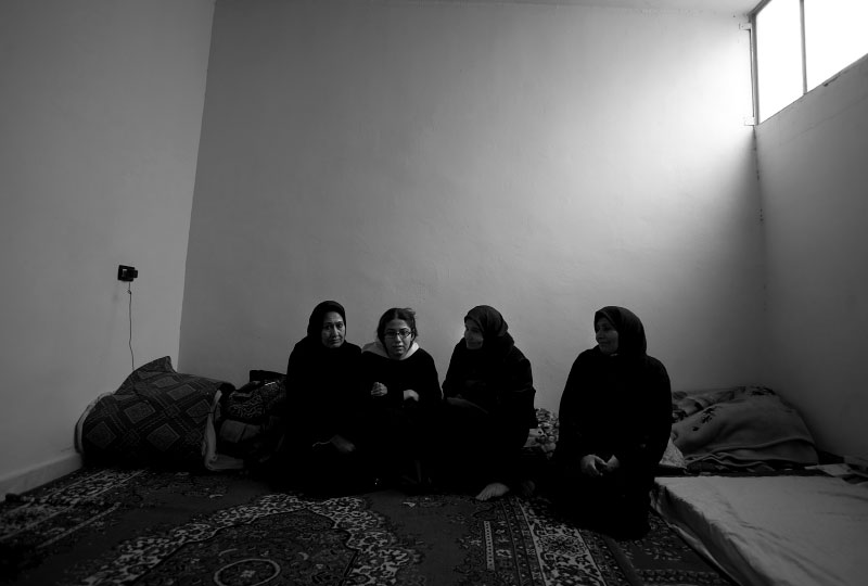 Three Iraqi women and a daughter share a small apartment with no heat in outskirts of Damascus, Syria, February 24, 2008. Men in their household are either kidnapped and missing or killed in Iraq.
