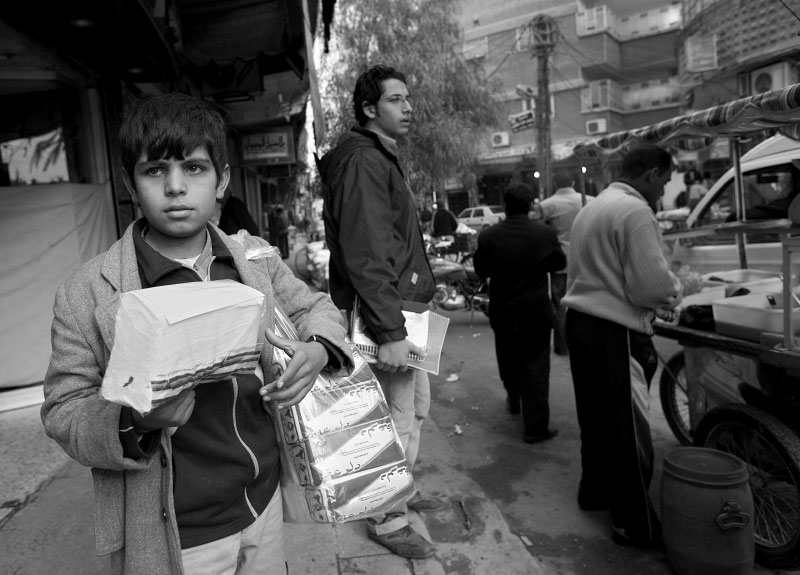 Ali, 9, sells tissue on the street of Sayed Zainab, Damascus suburb December 9, 2007. Both of his parents are killed in Iraq and now he lives with his uncle. He sells tissue paper on the street to help his adopted family. Although Syrian government allows Iraqi children to attend public school, it is estimated by Unicef that the only 10 percent of Iraqi children are enrolled to school mainly because their cannot afford it, and children has to work to support their family.