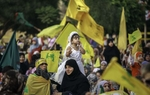 A girl dressed as princess is a part of tens of thousands gathered waved yellow Hezbollah flag at the welcoming ceremony of 5 released prisoners being held at Beirut's southern suburb Wed. July 16, 2008.  Five prisoners, most notably Samir Kuntar, were swapped by Israel in exchange for the bodies of two soldiers who were taken during the July War in 2006. Kuntar was 16 when he was captured, and was in captivity for 29 years.