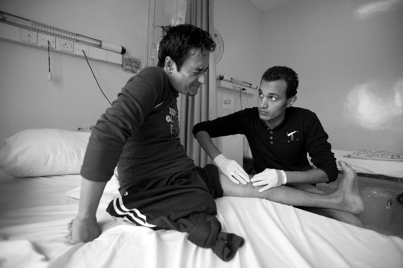 "Mohamad, 37, receives a physical therapy from Faris Baniysen, Jordanian physiotherapist, on his hospital bet at Red Crescent Hospital in Amman, Jordan Monday, November 12, 2007. Oil ministry employee, was trying to flag a taxi to get to work when a car bomb exploded, and a piece of car landed on him, receiving multiple fracture on his body on March 2006, and later his right leg was amputated. He said that a doctor told him that the amputation could have been avoided if there is better medical care available. ""I want to improve despite of everything."" One of his brother died recently in car bombing, 5 months after his own."