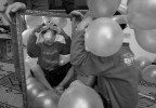 Abdullah, 7, is playing with balloons in a children's room created in a local hotel where the patients spend time to recover. The day after his grandfather was shot to death, Abdullah, then 6, stood with his father at the funeral tent in Baghdad. After a bomb exploded at a market down the street, neighbors began rushing toward the scene. Then the second attack came to them near the tent they were standing by.For three days, relatives looked for Abdullah in Baghdad's hospitals until they found him in a hospital where he had been driven by a neighbor. During that time, his father was recovering at another hospital of his own injuries begging his brothers for news of Abdullah. In December 2006, Abdullah flew to Jordan, escorted by an uncle. His father soon followed, in part to seek treatment himself. He has lost his left foot, he face was crashed and lost his left eye, and has gone through 6 surgeries so far.