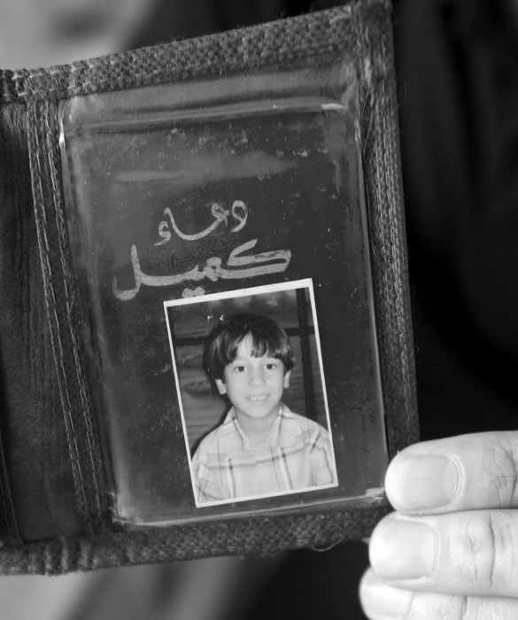 Abdullah's father keeps the photo of Abdullah before the car bomb explosion.