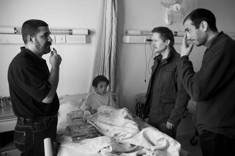 Dr. Eckardt explains the surgery to his father through an interpreter.