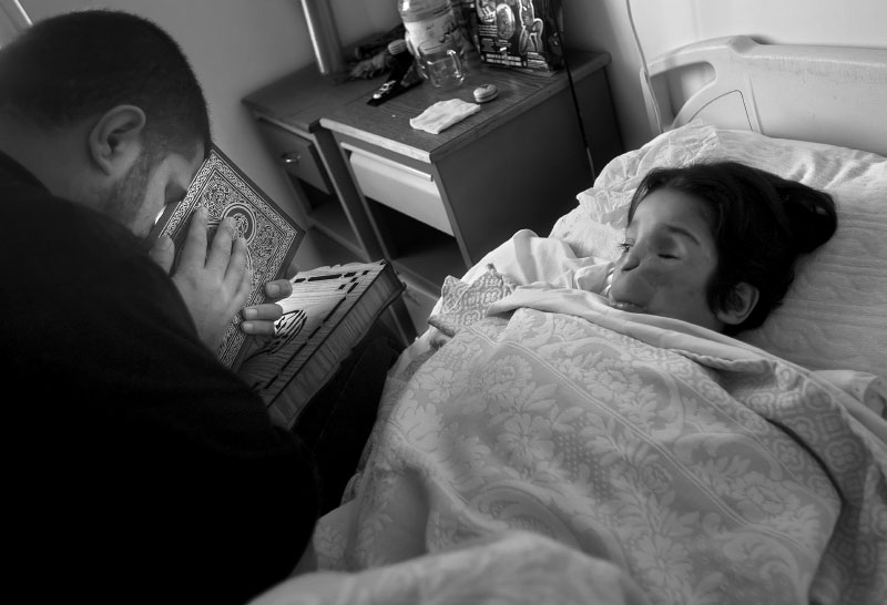 Father of Abdullah reads passage in Koran before surgery March 4, 2008.