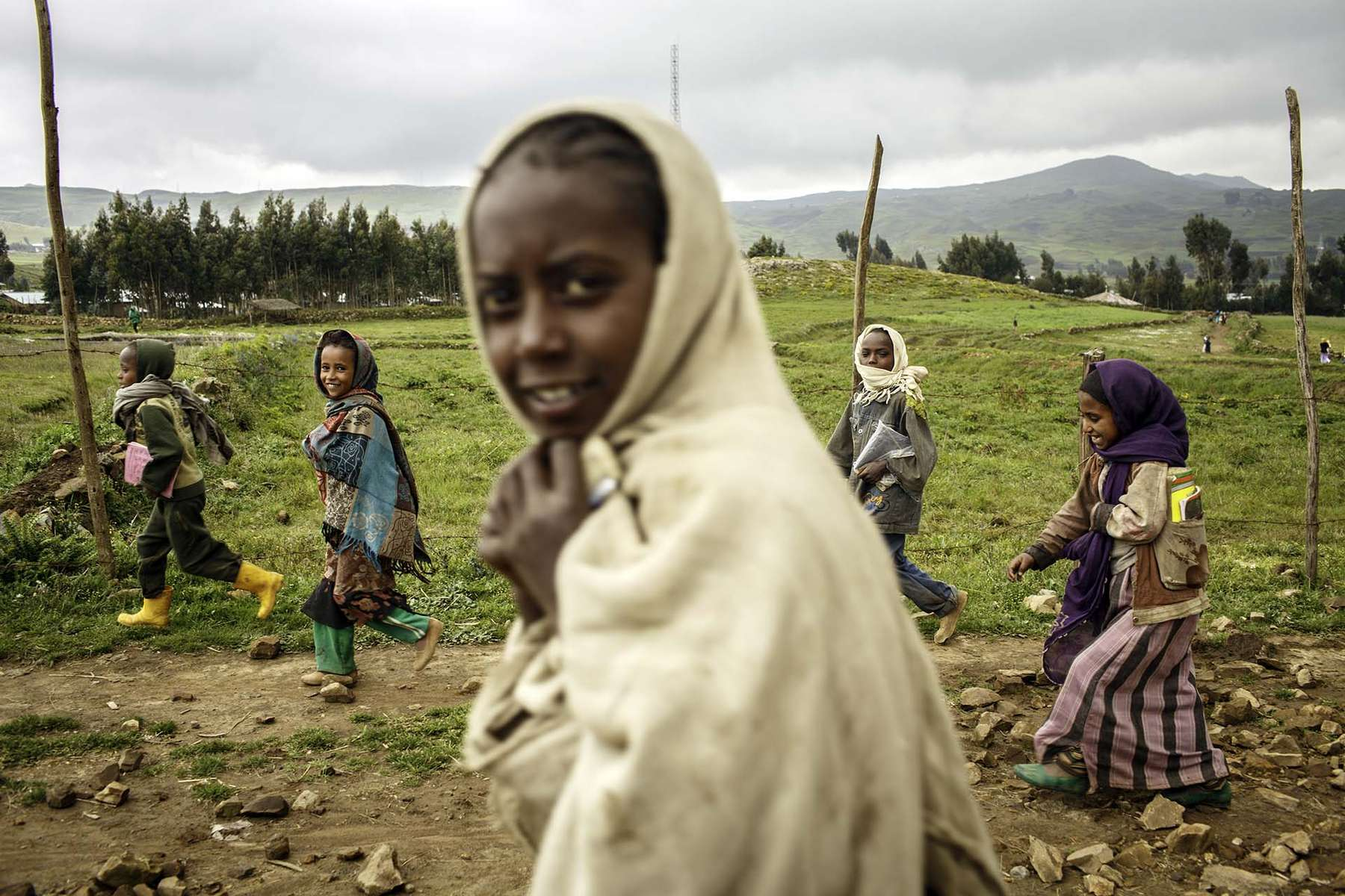 Children return home from school in the village of Guguftu in Amhra region of Ethiopia 9 October 2013.