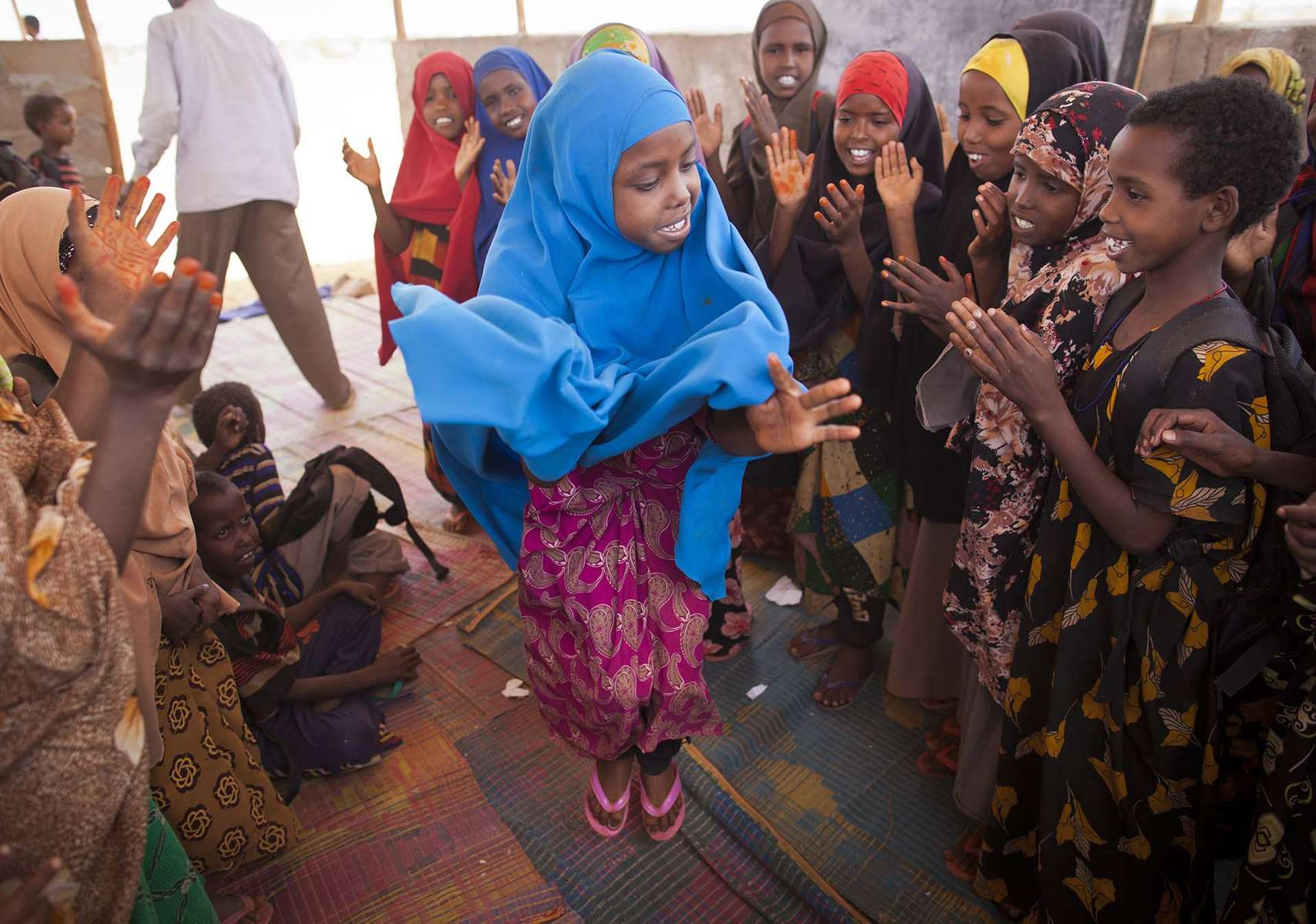 Refugee children engage in a tradtional song and dance at Buramino Refugee Camp in Dolo Ado in Ethiopia Thursday, March 8, 2012.