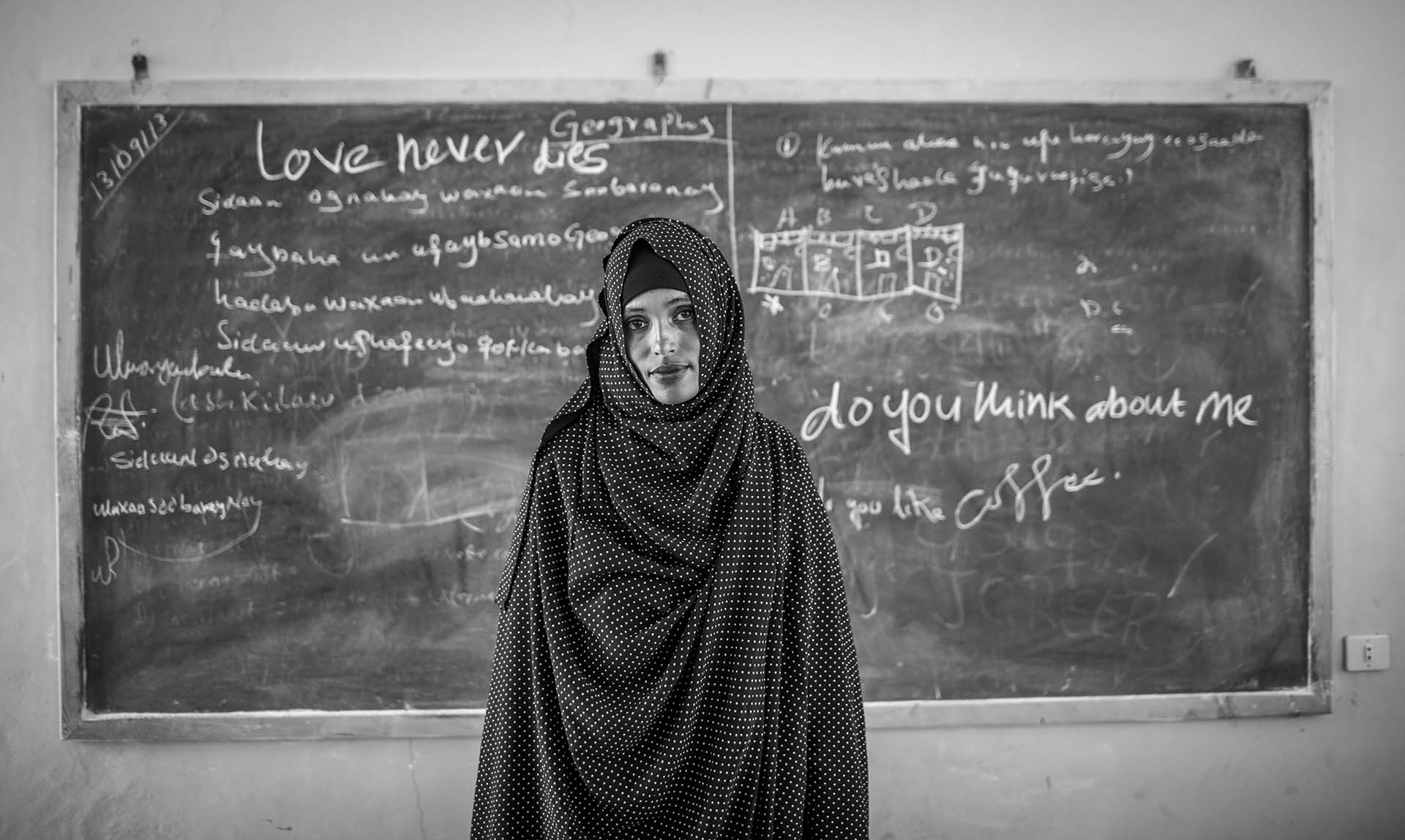 Somali refugee Nemha poses for a photo in a classroom at the secondly school in Sheder Refugee Camp in Somali region of Ethiopia 16 September 2013. All her family members were dead and she is living with other females in a camp.