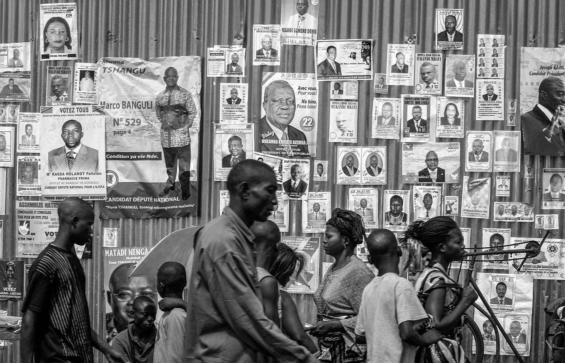 Posters of candidates for presidential and national elections occupy every inch of the wall in Kinshasa Tuesday, July 25, 2006. There are 32 presidential candidate alone. As the presidential and national election draw near on July 30th, the mood in the capital is tense. The war-torn Central African republic last had the election more than 40 years.