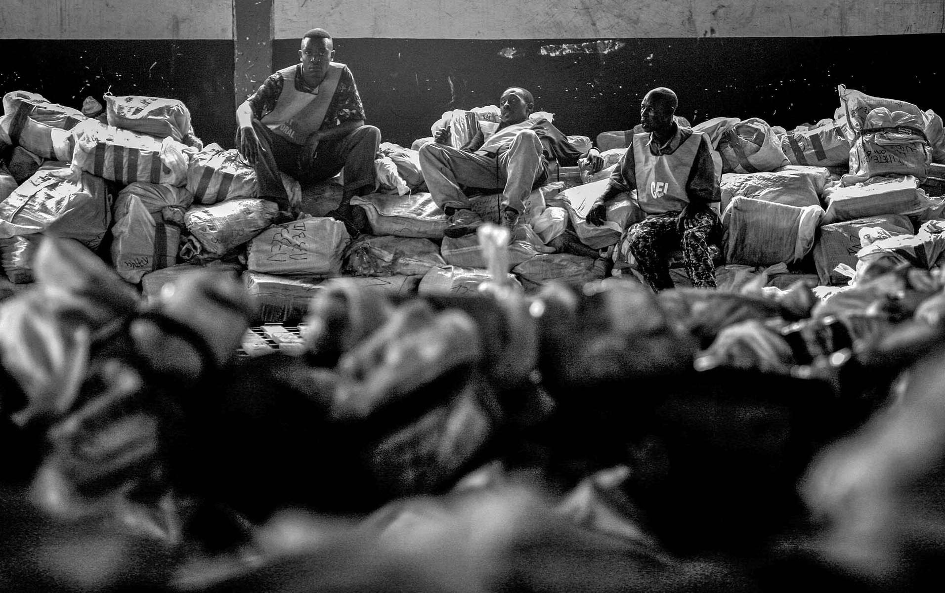 A tired electoral worker take a brake from sorting ballots for being accounted and recorded at a heavily guarded storage facility in Kinshasa Tuesday, October 31, 2006.