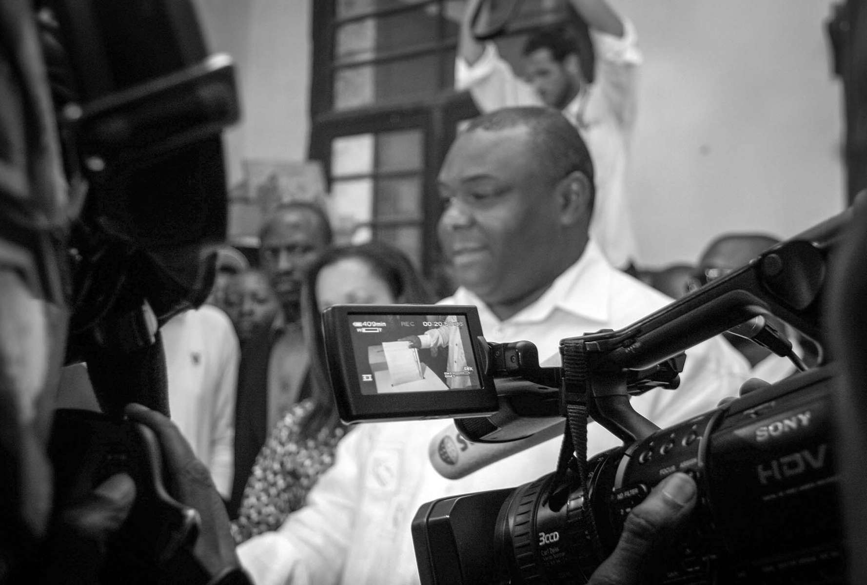 Jean Pierre Bemba, current vice president, former warlord, and presidential candidate casts his vote.
