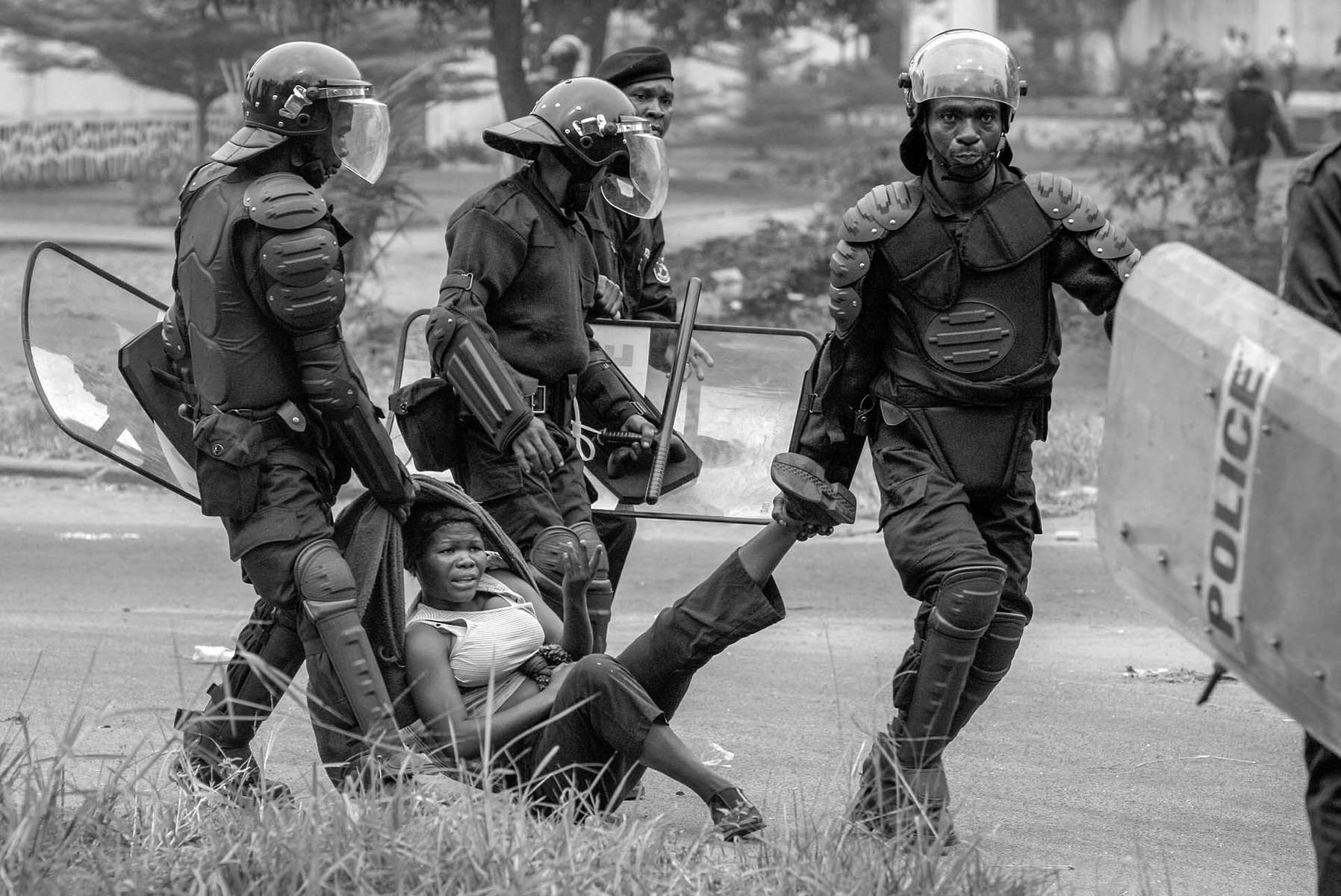 Riot police arrest a supporter of UDPS, Congo's main opposition party which boycotted the upcoming Presidential and National election, on the street of Kinshasa June 30, 2006, the nation's independence day.