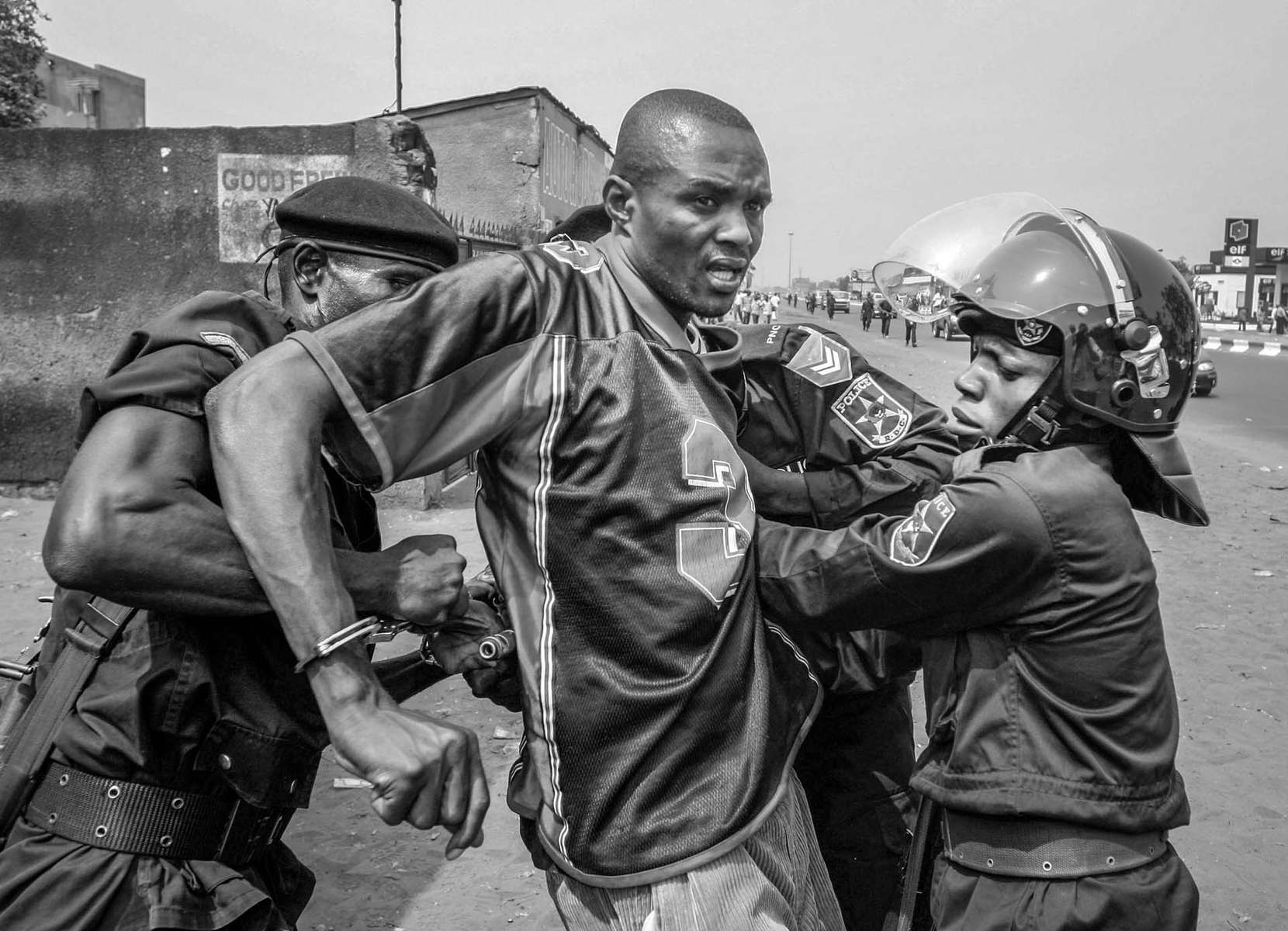 A protester from UDPS is being arrested by the riot police in Kinshasa.