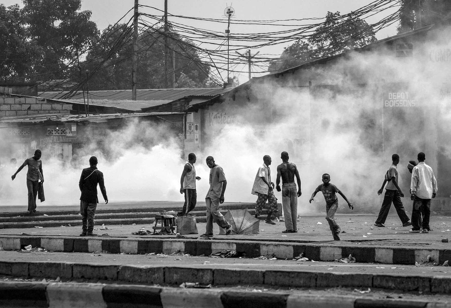 Tear gas fills the streets of Kinshasa during the protest by UDPS opposition supporters.