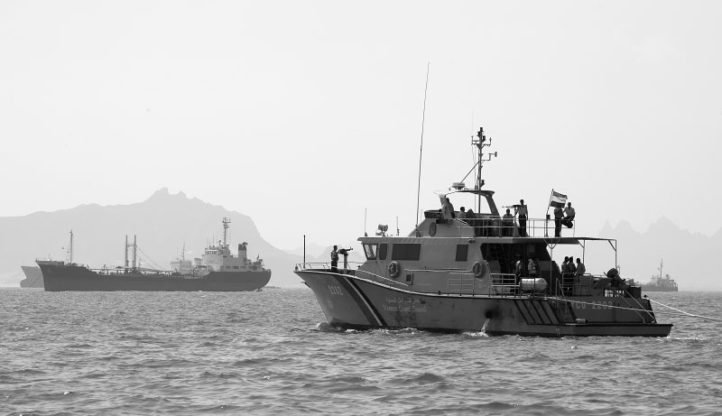 Yemeni coast guard ship navigates through Aden harbor. The coast guard of the poorest nation in Middle East is overwhelmed and under-equipped to deal with Somali smugglers for refugees and illegal goods, and the pirates along their long coast line.