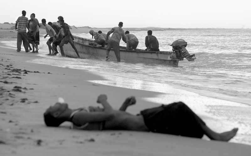 Refugees who were lost in the sea were rescued by local fishermen and brought to a shore after being forced into the water offshore. But many of their fellow passengers were not so lucky, lost their lives to the sea.