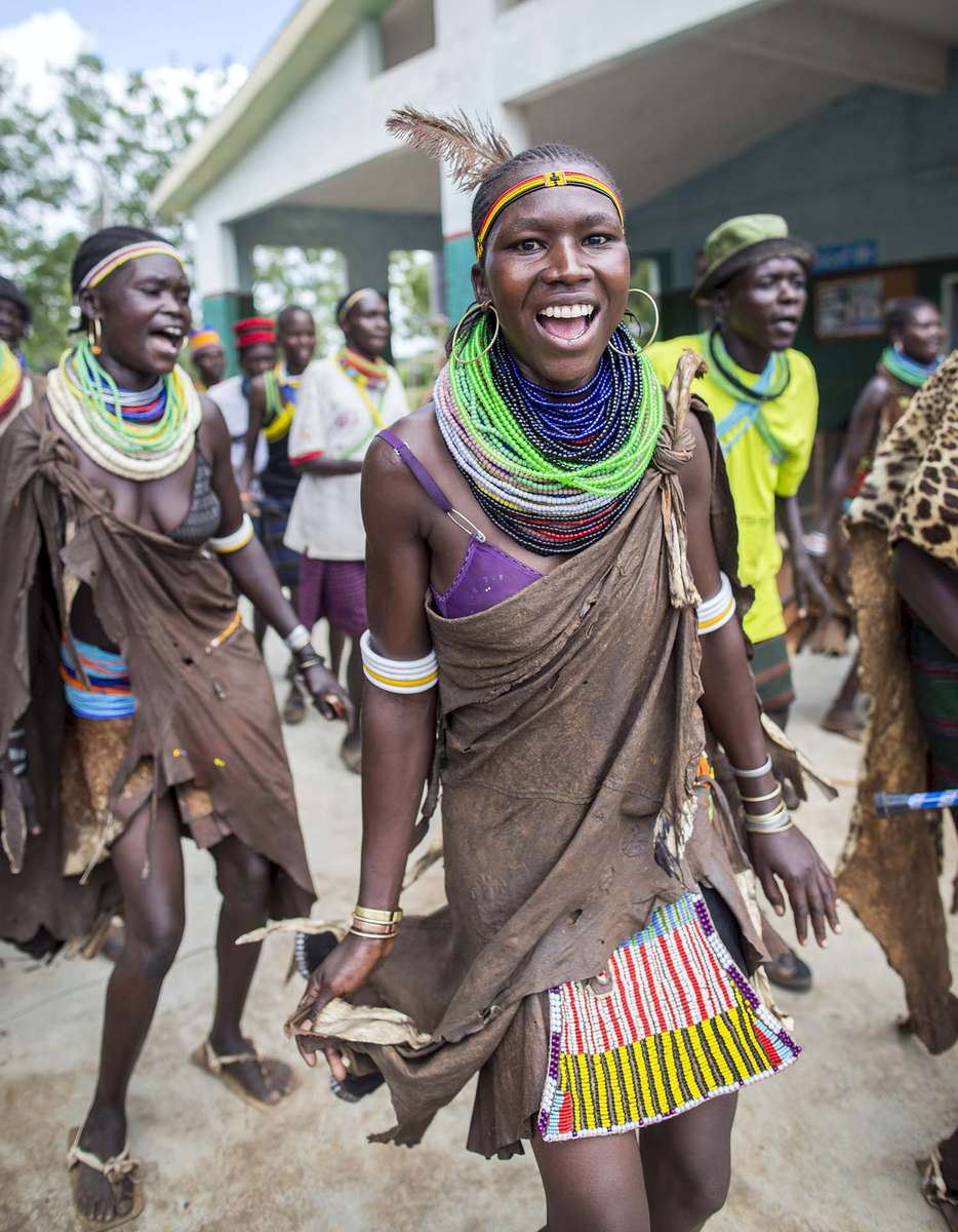Guests are welcomed by Karimojong people at St. Pius Kidepo HC III in Moroto Thursday 3 December 2015.