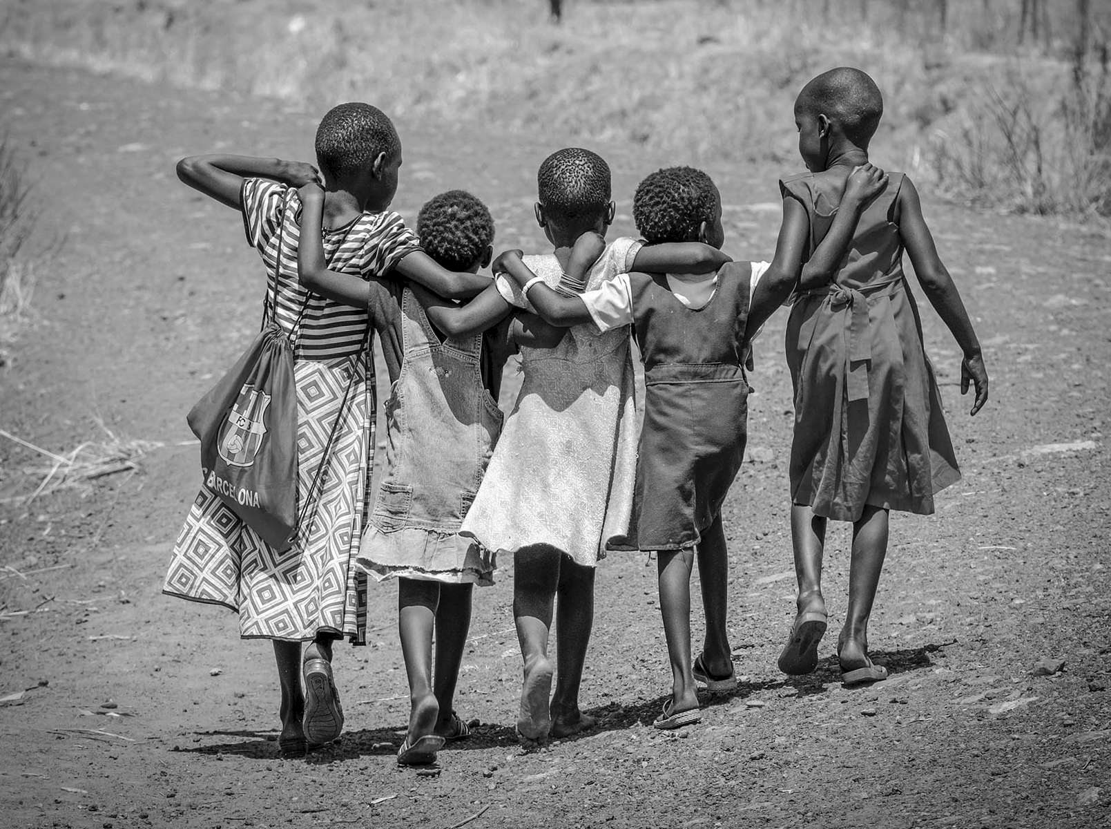 Refugee children walk home together after school in Nyumanzi refugee settlement on 2 March, 2017. With thousands of new arrivals fleeing to Uganda every day, South Sudan is now Africa's largest refugee crisis and the world's third after Syria and Afghanistan – with less attention and chronic levels of underfunding.